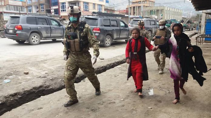 Security personnel escorting those trapped inside the gurdwara attacked by IS gunmen in Kabul, Afghanistan | Twitter | @TOLOnews