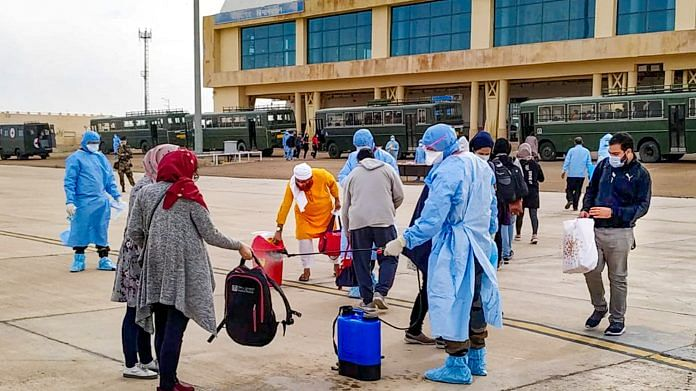 Indian nationals evacuated from Iran undergo a disinfectant process before being quarantined in Indian Army Wellness Facility Centre at Jaisalmer Military Station