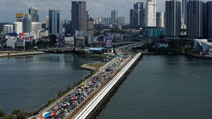 Commuters take the Woodlands Causeway to Singapore from Johor a day before Malaysia imposes a lockdown on travel on 17 March   ANI Photo via Reuters