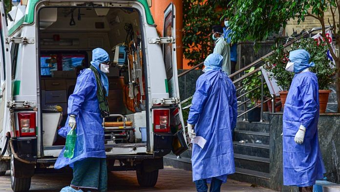 Medical workers attend to a suspected coronavirus patient as he is shifted to the isolation ward of Gandhi Hospital, in Hyderabad