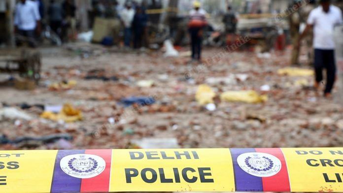 A police tape cordons off an area in Northeast Delhi that witnessed the communal riots | Photo: Suraj Singh Bisht | ThePrint