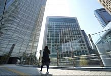Representational image. A morning commuter walks in the Shiodome business area in Tokyo, Japan. (Representational Image) | Photographer: Toru Hanai | Bloomberg