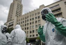Brazil's Marine Corps soldiers from the Nuclear, Biological, Chemical and Radiological Defense Company perform disinfection operations at Tram (VLT) stations in downtown Rio de Janeiro, Brazil. (Representational Image) | Photographer: Andre Coelho | Bloomberg