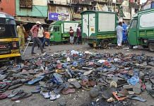 Mumbai: Footwear of protestors lying on the road after police action on migrant workers who assembled at Bandra Railway Station, Tuesday | PTI