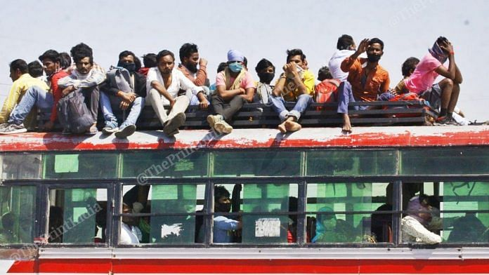 Migrant workers sit on top of a bus in Uttar Pradesh | Photo: Praveen Jain | ThePrint