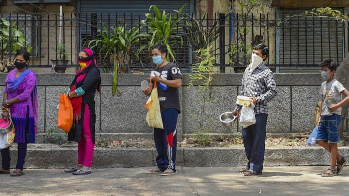 Representational image | People stand in a queue to collect free food distributed by volunteers during coronavirus lockdown, in Shahpur Jat area of New Delhi | PTI