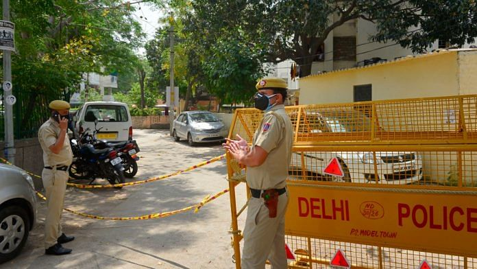 Delhi Police personnel stand guard at Model Town police colony, identified as a Covid-19 hotspot, during the on 16 April 2020 | Kamal Kishore | PTI