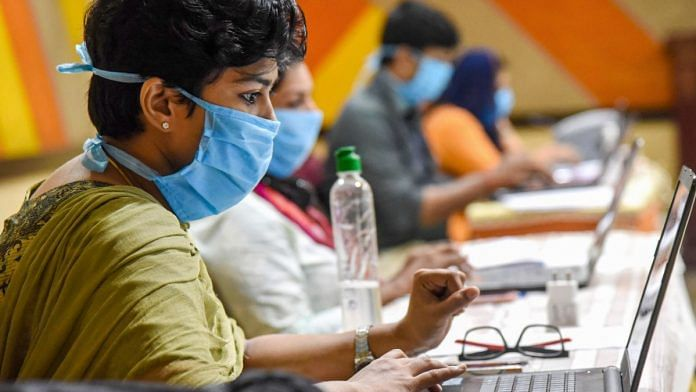 Employees of Health Tele Helpline center work during a nationwide lockdown in the wake of coronavirus pandemic, at IMA house Ernakulam District in Kochi on 18 April, 2020 | PTI