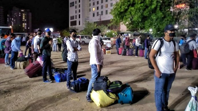 Students queue up to take the buses sent by the UP govt to get them home | Photo: Praveen Jain | ThePrint