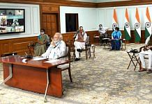 Prime Minister Narendra Modi and his ministers and officials interact with chief ministers via video conference Monday | Photo: ANI