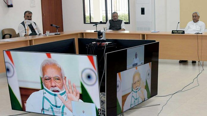 Bihar CM Nitish Kumar (right) and Deputy CM Sushil Modi (back, centre) in Monday's video conference with PM Narendra Modi | Photo: ANI