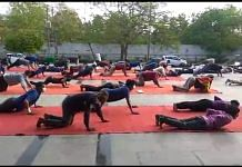 Migrant workers during a PT session at Yamuna Sports Complex in New Delhi