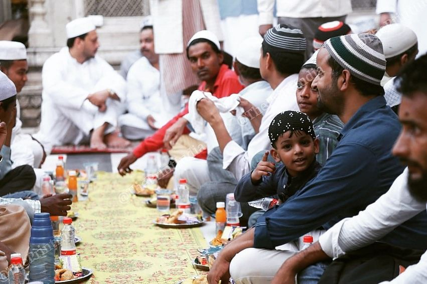 People sit for a community meal during Ramzan | Manisha Mondal | ThePrint File Photo
