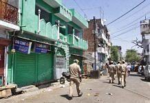 Police personnel walk through a locked down Sadar Bazar area where 12 new cases of coronavirus were reported | Praveen Jain | ThePrint
