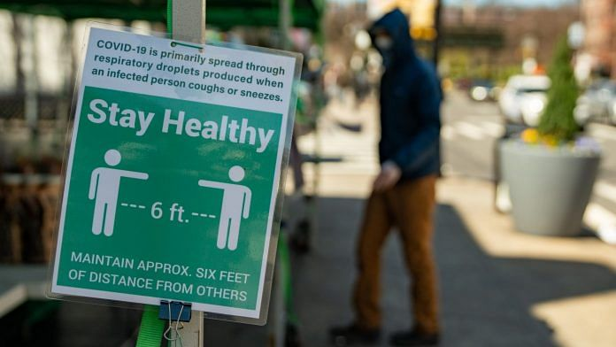 A sign instructs people to stay six feet away at a farmers' market in the Bronx borough of New York, U.S. | Photo: David Dee Delgado | Bloomberg