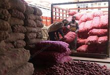 Labourers unloading sacks of onion in Azadpur mandi in Delhi | Photo: Manisha Mondal | ThePrint
