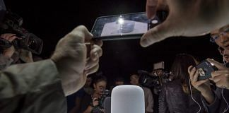 Attendees take photographs of the Apple Inc. HomePod speakers | Bloomberg