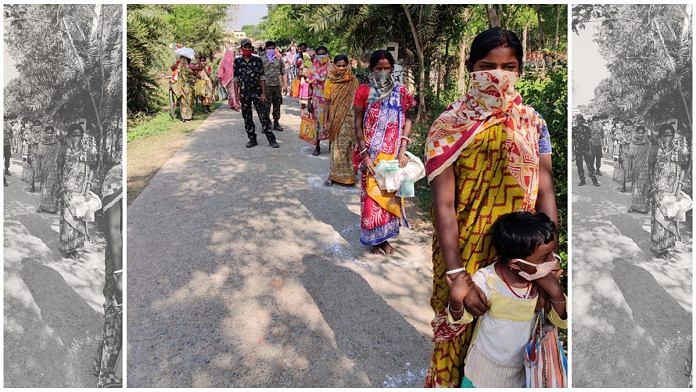 Residents of a village in Birbhum, West Bengal, stand in a queue to collect ration distributed by the district administration | By special arrangement