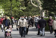 People wearing masks in a park in Shanghai, China | Qilai Shen | Bloomberg