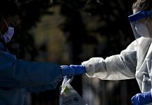 A Children's National Hospital healthcare worker places a vial into a Quest Diagnostics bag at a drive-thru coronavirus testing site at Trinity Washington University in Washington, D.C., U.S. (Representational Image) | Photographer: Andrew Harrer | Bloomberg
