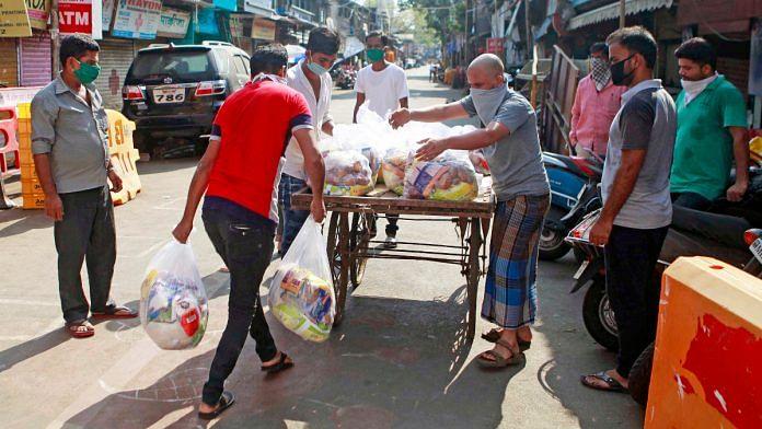 People distributing essential items in Worli, Mumbai | Photo: Ashish Raje/ANI