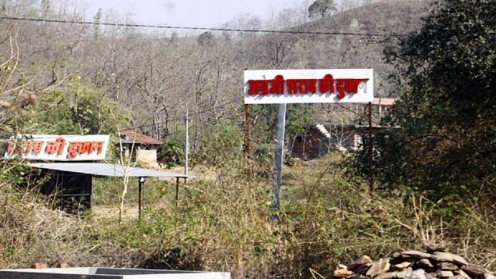 The Aravallis provide a grand backdrop to signage for local bars at Ratanpur village in Rajasthan | Praveen Jain | ThePrint