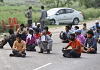 Migrants workers and laboures who were travelling to their respective places are sitting on the road and waiting for their turn to be screened at Uttar Pradesh - Patna border | Photo: Suraj Singh Bisht | ThePrint
