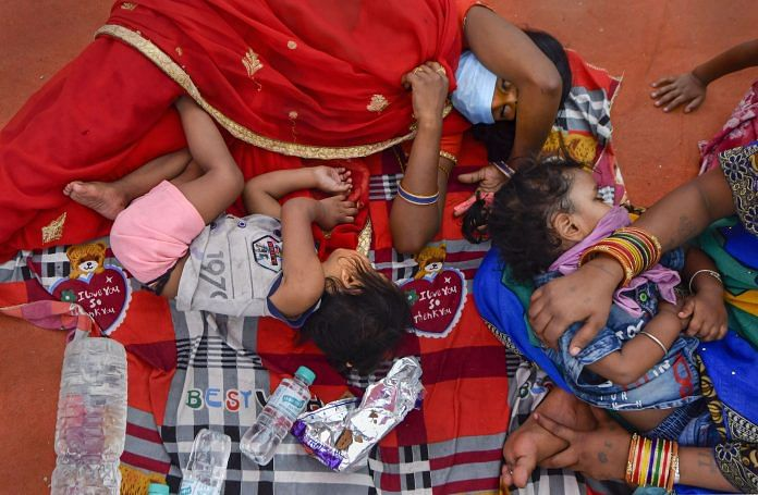 Representational image. Migrants rest while waiting for buses at Vinod Nagar to leave for their native places, during the fourth phase of the COVID-19 nationwide lockdown, in New Delhi, Thursday, May 21, 2020. (PTI Photo/Ravi Choudhary)
