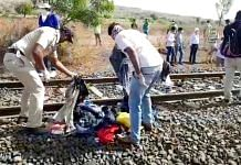 Police officials investigating at the railway track where 16 migrant workers died in a train accident in Aurangabad on 8 May 2020