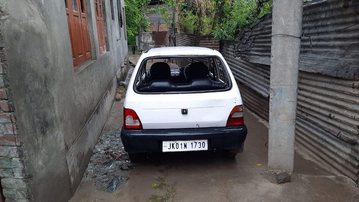 Sarpanch Ghulam Mohammad's Maruti car had its rear windscreen shattered | Photo: Azaan Javaid | ThePrint
