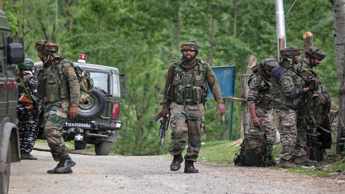 Security forces at the site of an encounter last week that killed five personnel, including two Army officers, in Kashmir's Handwara | PTI