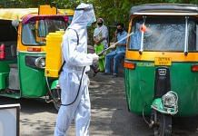 A health worker sanitises auto-rickshaws during Covid-19 lockdown in New Delhi | PTI File photo