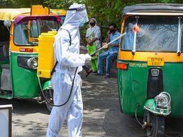 A health worker sanitises auto-rickshaws during Covid-19 lockdown in New Delhi | PTI File photo