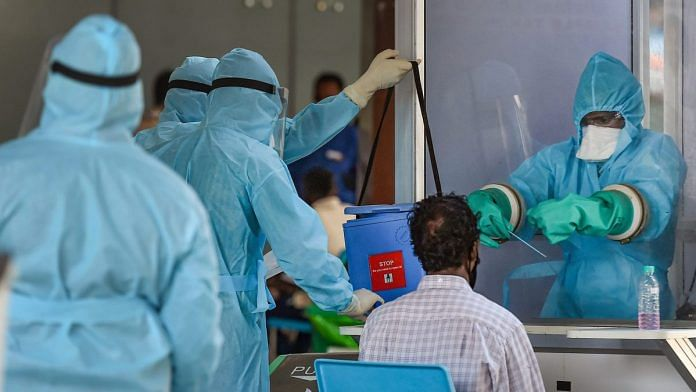 File photo of medic taking samples from an Indian national arriving from Myanmar at Anna International Airport, during the ongoing lockdown, in Chennai | PTI