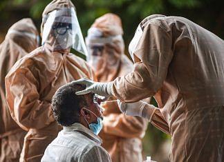 Medics collect a swab sample for COVID-19 (Representational image)   PTI