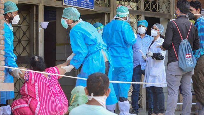(Representational image) Medics attend to a suspected Covid-19 patient at a government hospital during the ongoing nationwide lockdown to curb the spread of coronavirus, in New Delhi | Kamal Kishore | PTI