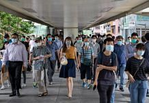Pedestrians wear protective masks in the Wan Chai district of Hong Kong. The study was conducted across six hospitals in the city | Paul Yeung | Bloomberg
