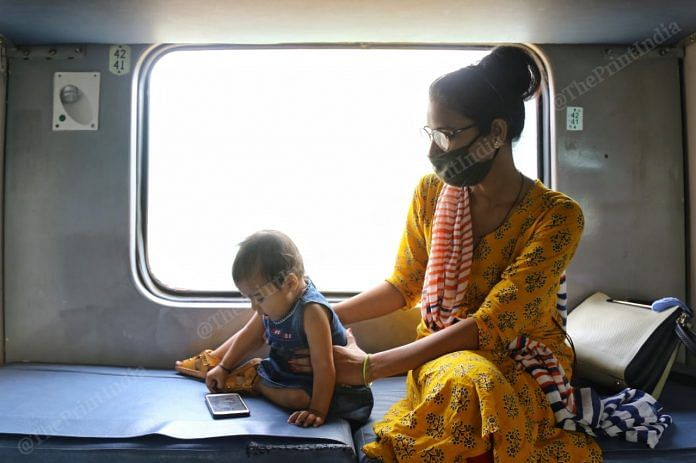 A woman travelling with her baby on a special train from New Delhi to Secunderabad | Photo: Suraj Singh Bisht