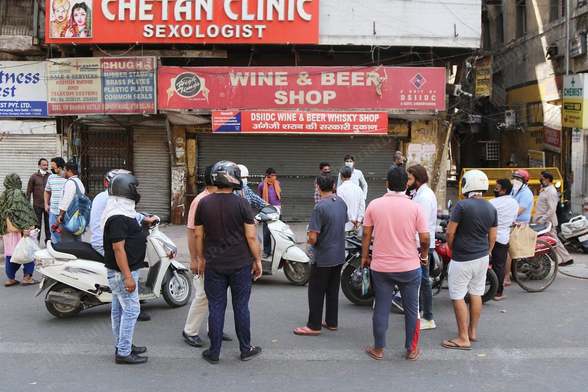 Crowd gathered outside 'Wine and Beer shop' in Daryaganj in hope that the shop will reopen | Photo: Manisha Mondal | ThePrint