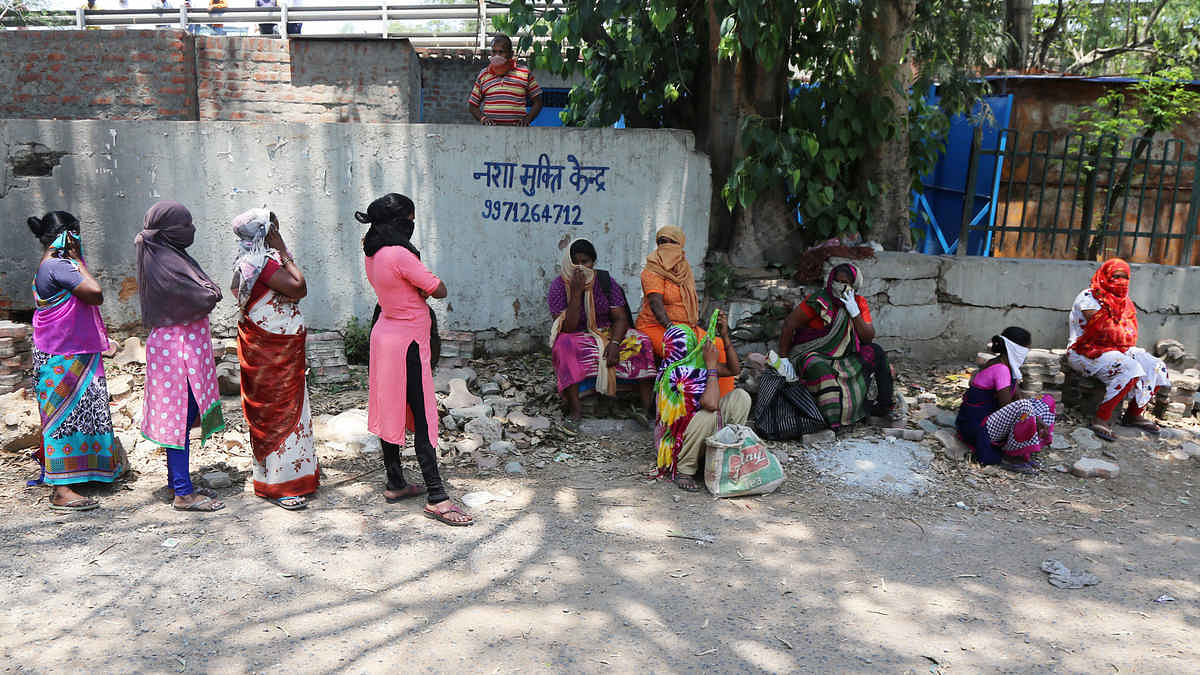 Women queue up outside the Shrinivaspuri liquor store | Photo: Manisha Mondal | ThePrint