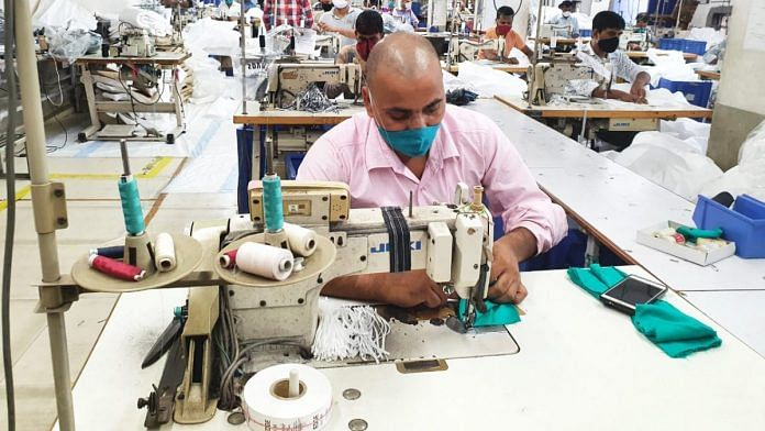 There are 30 men to stitch the cloth | Photo: Soniya Agarwal | ThePrint