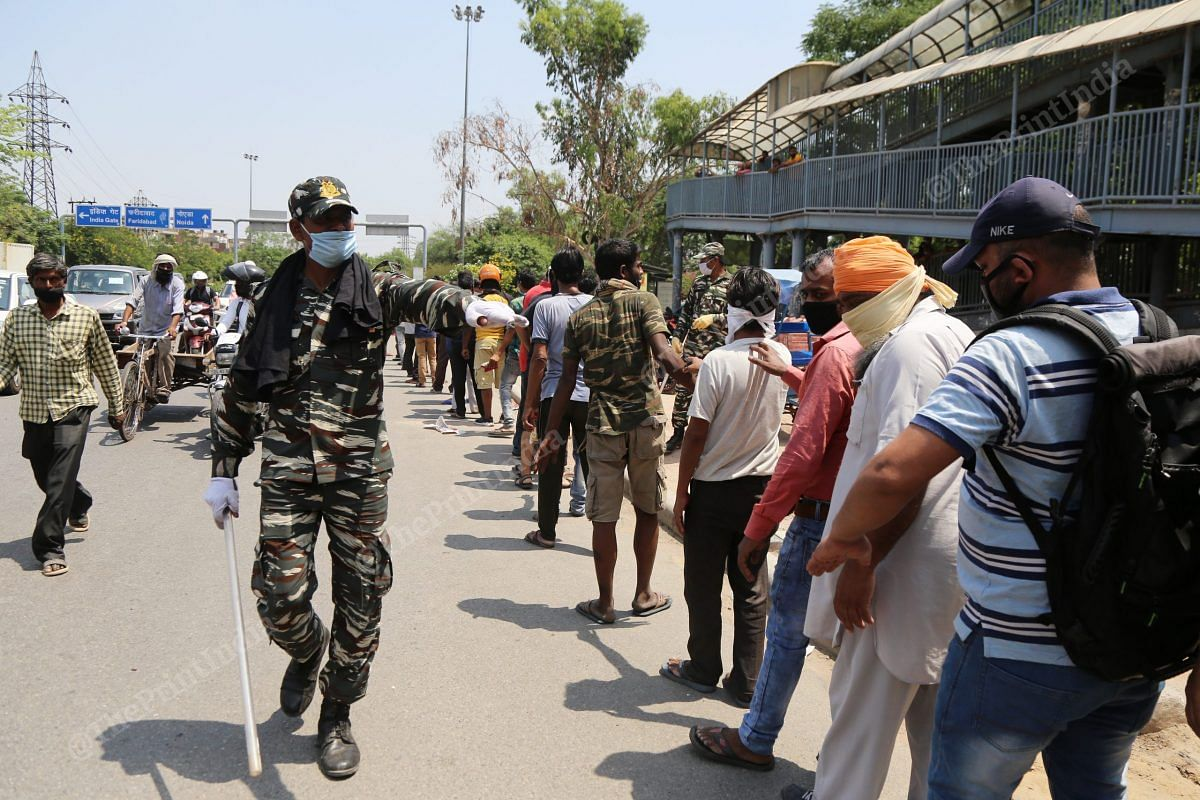 CRPF personnel asks to maintain one hand distance | Photo: Manisha Mondal | ThePrint