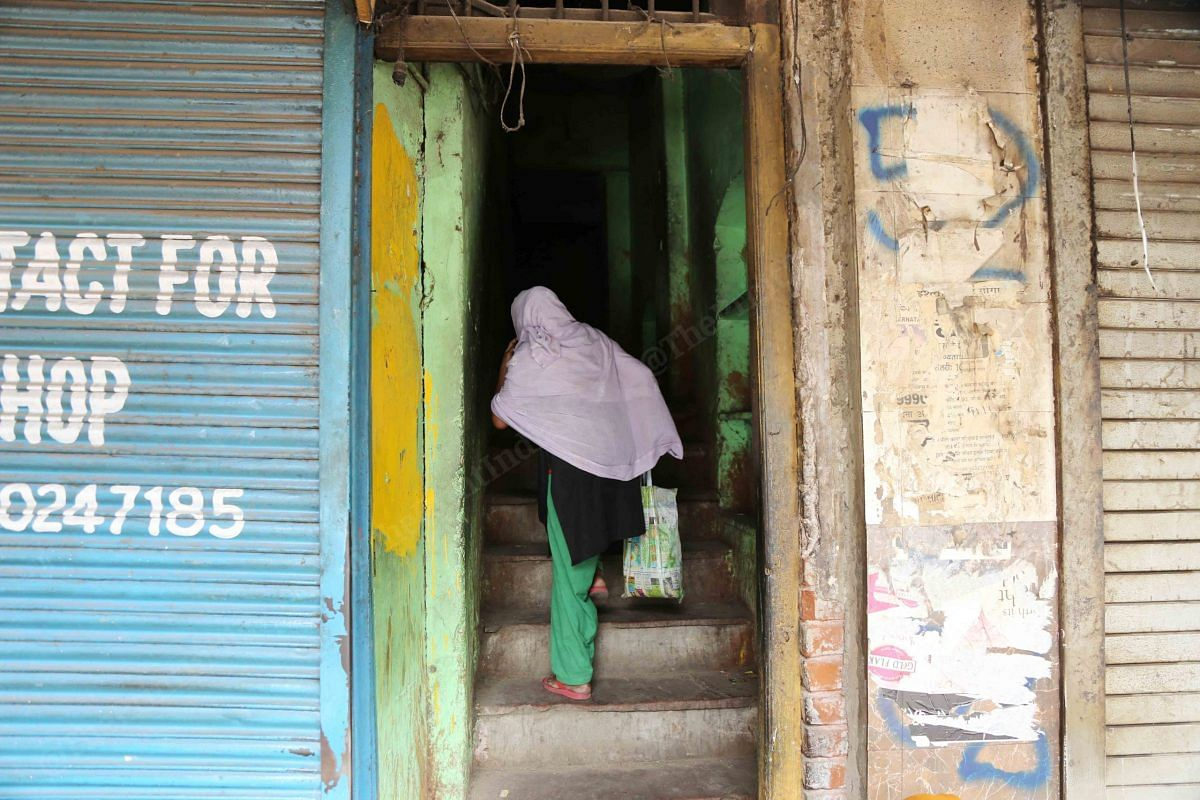 A woman carries ration to the third floor   Photo: Manisha Mondal   ThePrint