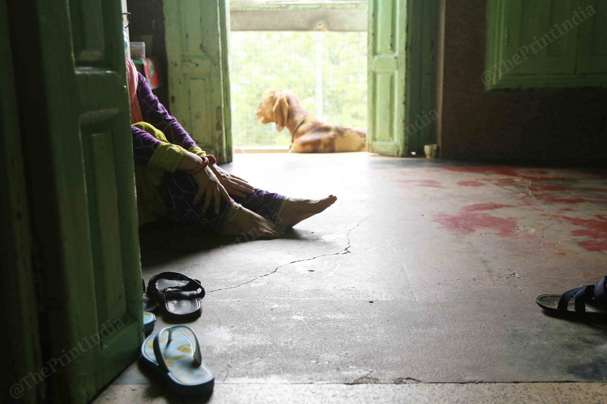 After bringing ration to the third floor, a woman rests   Photo: Manisha Mondal   ThePrint