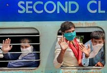 File photo | Migrant labourers wave from a train as they leave for Barauni in UP, during the nationwide lockdown, in Amritsar, 10 May | PTI