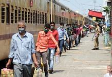 Migrants from Tamil Nadu at Danapur station board a train to reach their destination, in Patna on 11 May 2020