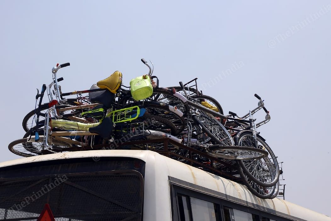 A testimony to their long journey - bicycles stacked atop a bus at the UP-Bihar border | Suraj Singh Bisht | ThePrint