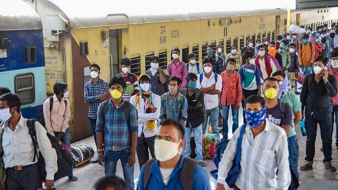 Migrants from Jaipur arrive by Shramik Special train at Danapur junction, during the nationwide lockdown to curb the spread of coronavirus