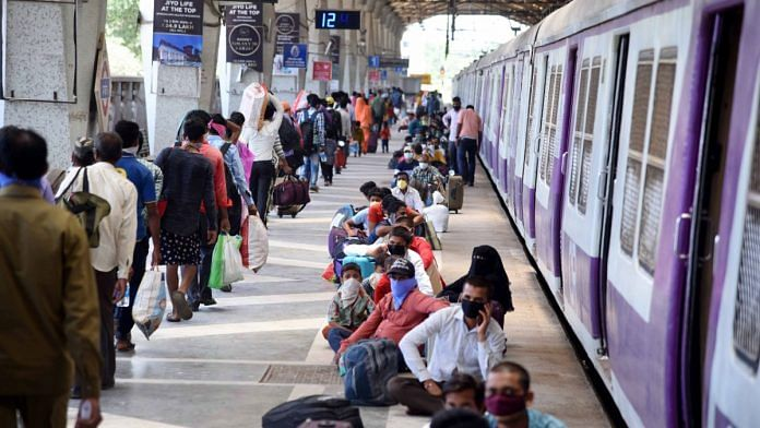 Migrants from Lucknow wait to board Shramik Special train to reach their native places at Panvel Railway Station, during the ongoing Covid-19 lockdown, in Navi Mumbai, on 20 May | PTI