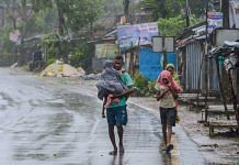 Villagers walk on a road during a storm due to Cyclone Amphan at Kakdwip near Sunderbans area in South 24 Parganas district of West Bengal, Wednesday, May 20, 2020. (PTI Photo)